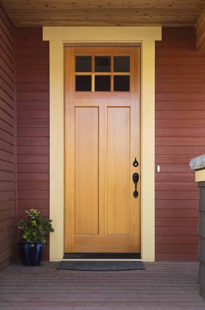 Light solid wood front door for a residential home