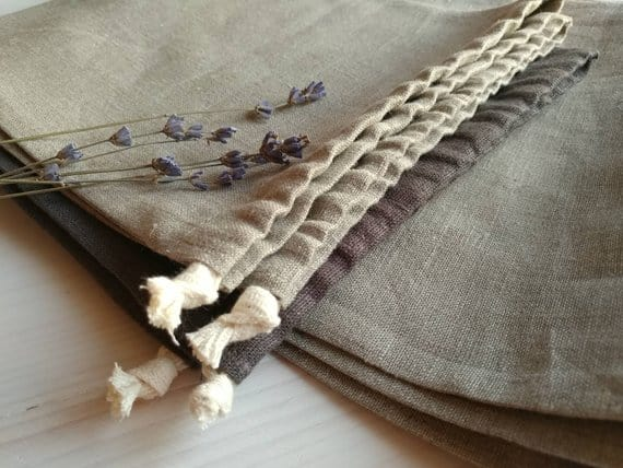 Linen bread bags with dried lavender on top.