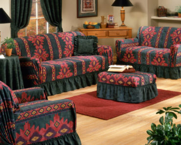 Living room furniture covered with black and red, printed slipcovers.