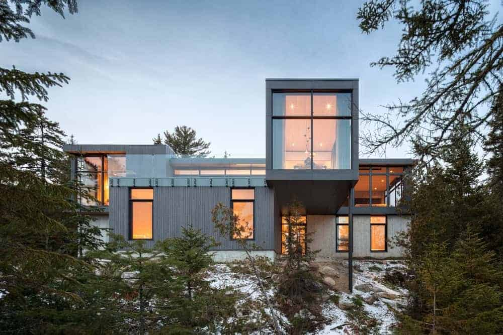 Large and long horizontal modern house with gray exterior and a breathtaking view of the surroundings.