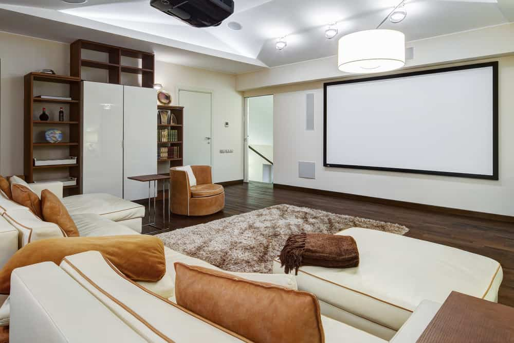 Check out the huge sofa with two sections in this media room... two people have loads of plush space.  The room isn't all that great; it's too plain, but it does the job - a good example of how to create an inexpensive home theater in any space.