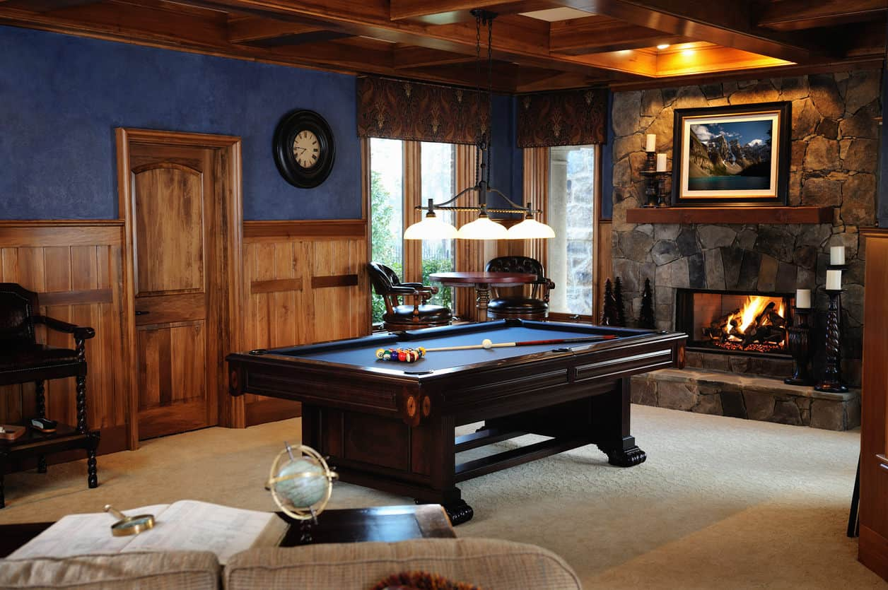 Very cool man cave room with pool table and sofas.