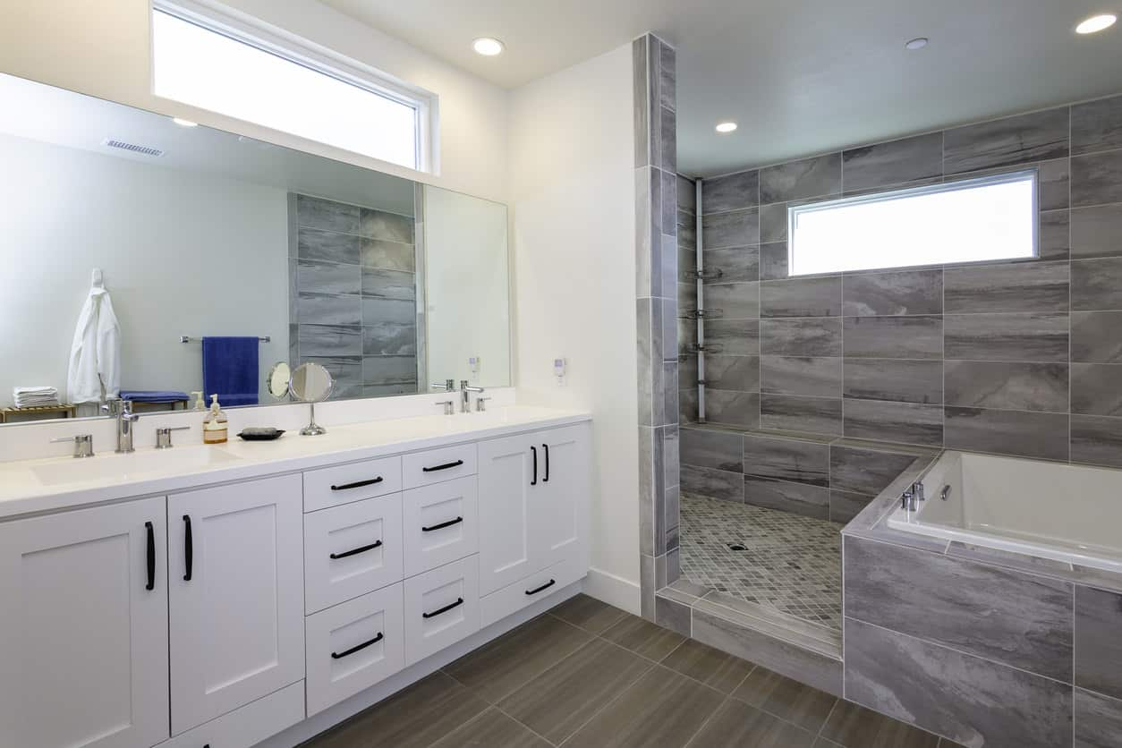 What I like about this primary bathroom design is how the tub forms part of the walk-in shower. It's a very clever use of space that enables both tub and walk-in shower without taking up a lot of space. This is one very smart designer.