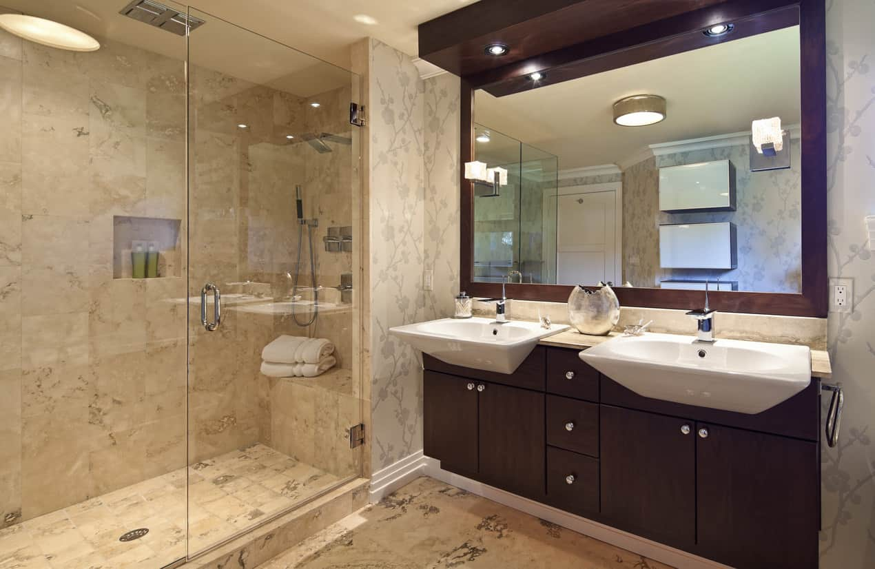 I think the wall tile is too color textured for my liking, but I include this in our gallery because I know this style is popular and I'm all about offering a variety of design ideas. It's too much for my eye, but the walk-in shower is nice as is the built-in floating vanity with the jutting white basins.