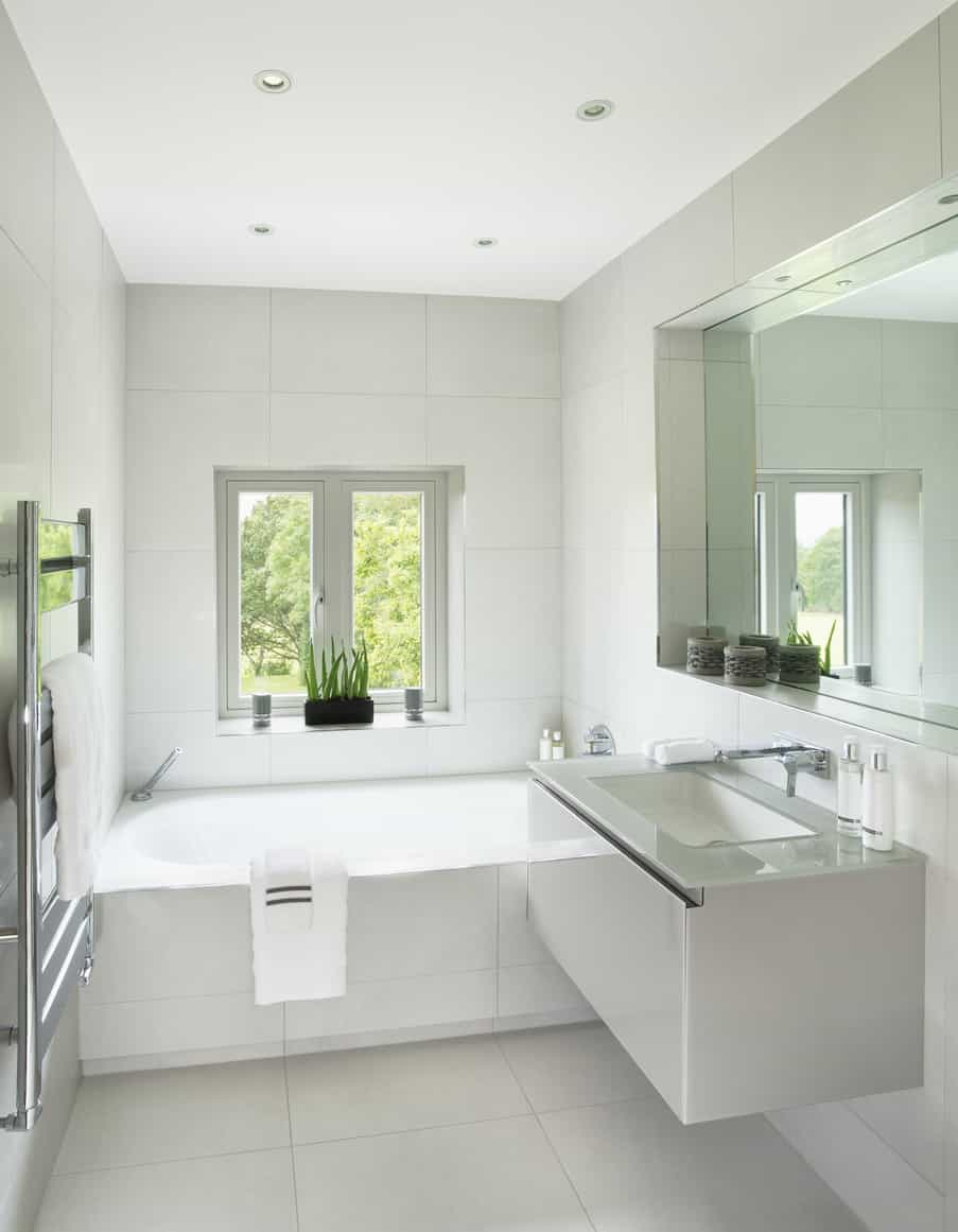 Here's another example of a fantastic small primary bathroom with tub and floating vanity. I'd be very happy with this as my primary bath (needs a shower head in the tub though) despite it's size.