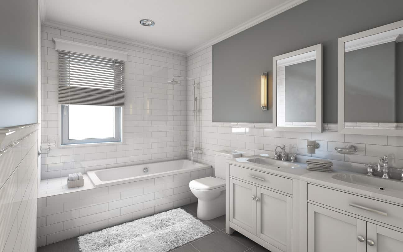 I'm a sucker for subway tile anywhere and this large white master bathroom has loads of white subway tile which makes it spectacular. The side-by-side vanities with matching mirrors is awesome. The grey accent wall along with grey tile floor add enough color contrast to the otherwise all-white en suite.