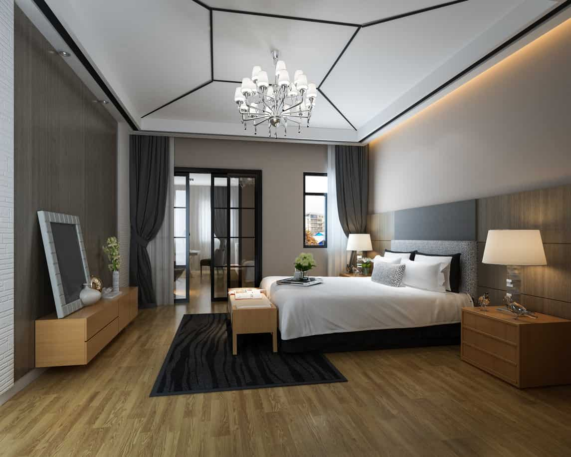 Here's a modern masculine bedroom design with chandelier, wood flooring and adjacent office. I love the white ceiling with black outline pattern.