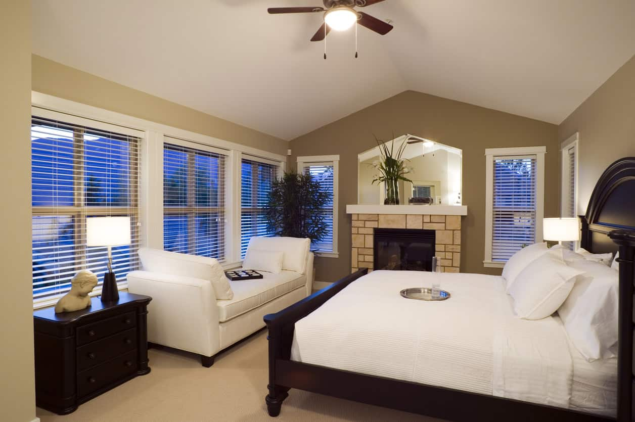 What An Awesome Master Bedroom In Traditional Style With A Contemporary Dark Wood Bed And White