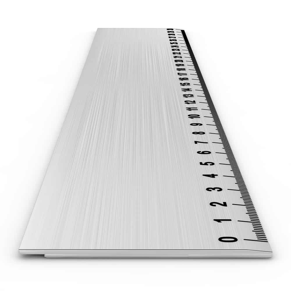 Metal ruler on white background.