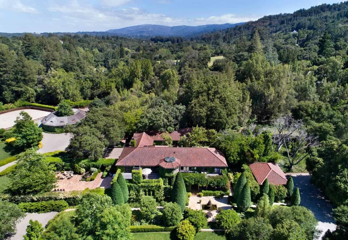 Aerial view of the estate featuring a beautiful landscaping and house architecture.