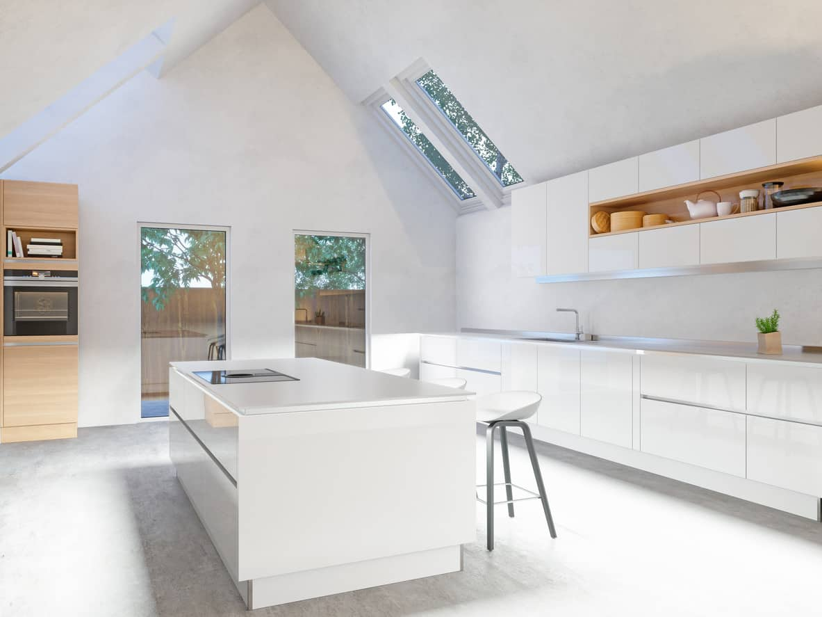 Minimalist all white modern kitchen with smooth surface cabinetry the cathedral ceiling nicely opens up