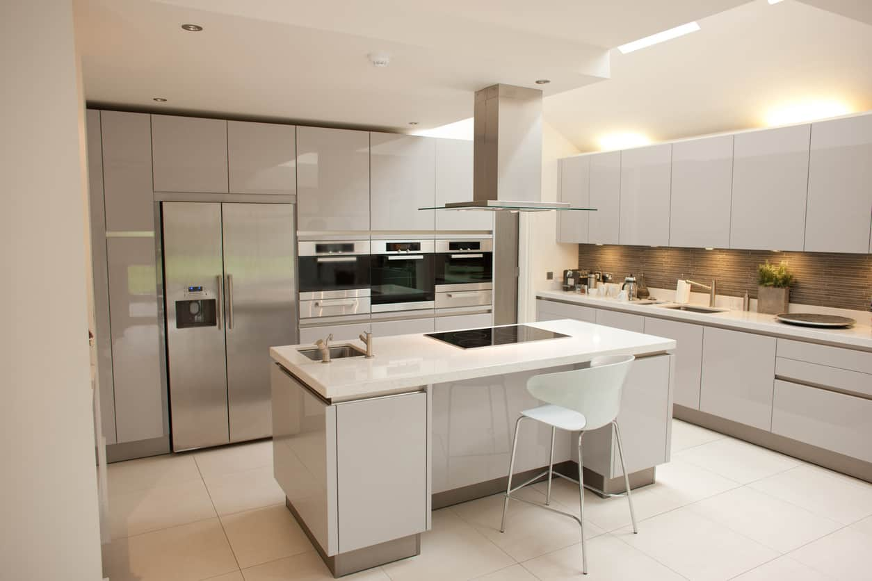 Latest Kitchen Designs Photos Large all white kitchen with smooth-faced cupboards and white tile floor.  Frankly,