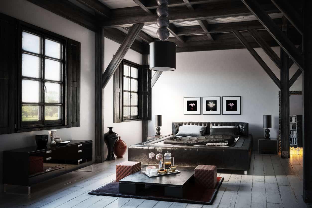Very masculine modern primary bedroom design (rendering) with dark ceiling beams and trim on light wood floor. Furniture includes black platform bed.