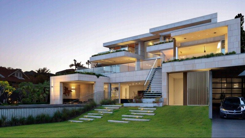 The outdoor front view of the features its beautiful modern architecture and landscaping. Photo Credit: Justin Alexander