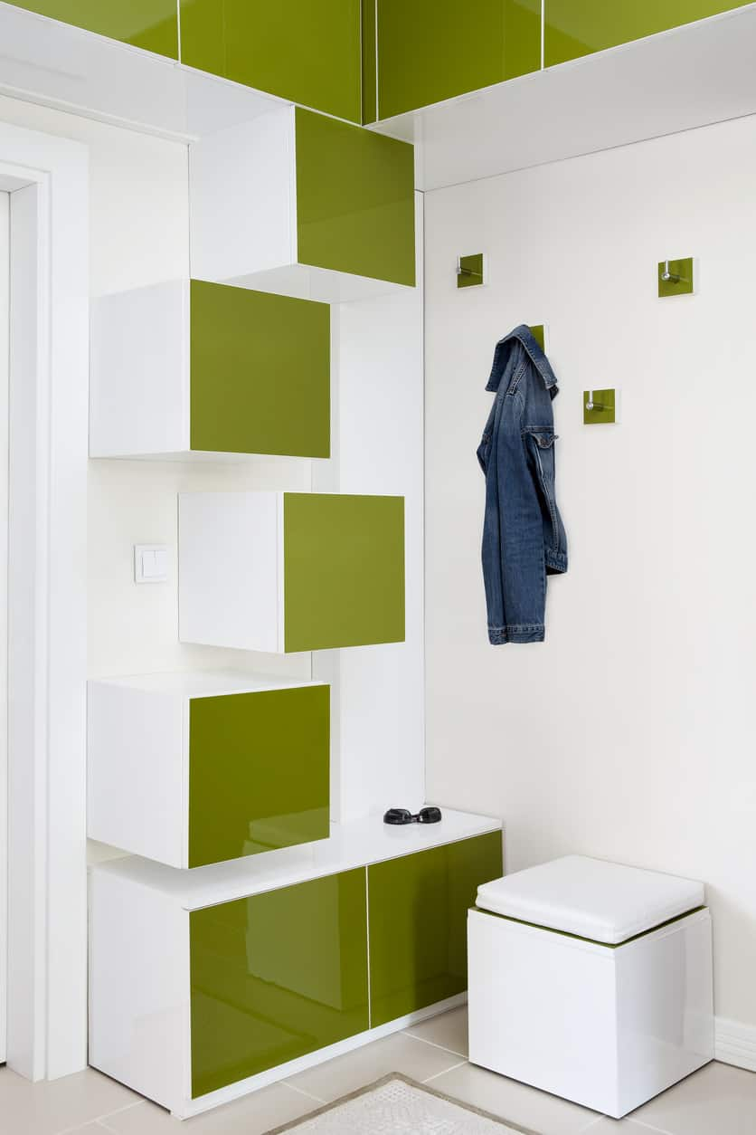 If you want your mudroom to be a little stylish, this is a great option for you with 3D cube storage shelves that follow a green and white color theme. The hooks also carry forward the two-colored theme, making this mudroom quite chic and funky-looking.