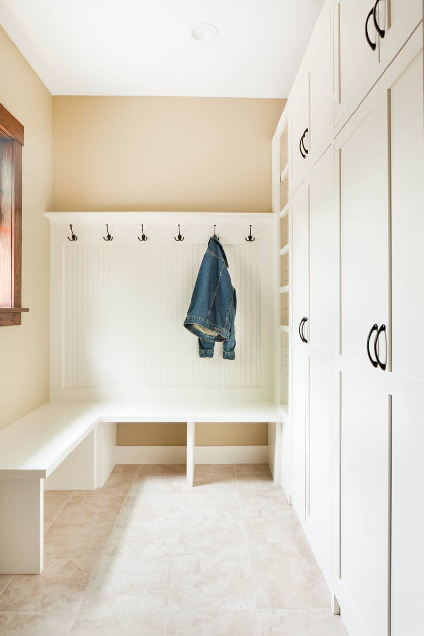 With the addition of a window, this mudroom takes on a different look and has well-built storage cupboards where you can store all sorts of things. It also has a slightly bigger bench than many other mudrooms, allowing for added storage.