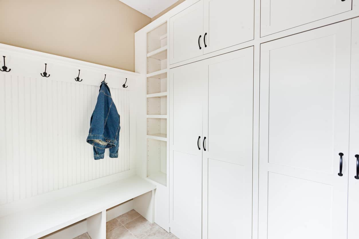 This is also a small mudroom but with the addition of an in-built wardrobe, and the usual bench, rack and a few hooks for clothes. It is small yet sufficiently built for proper storage.