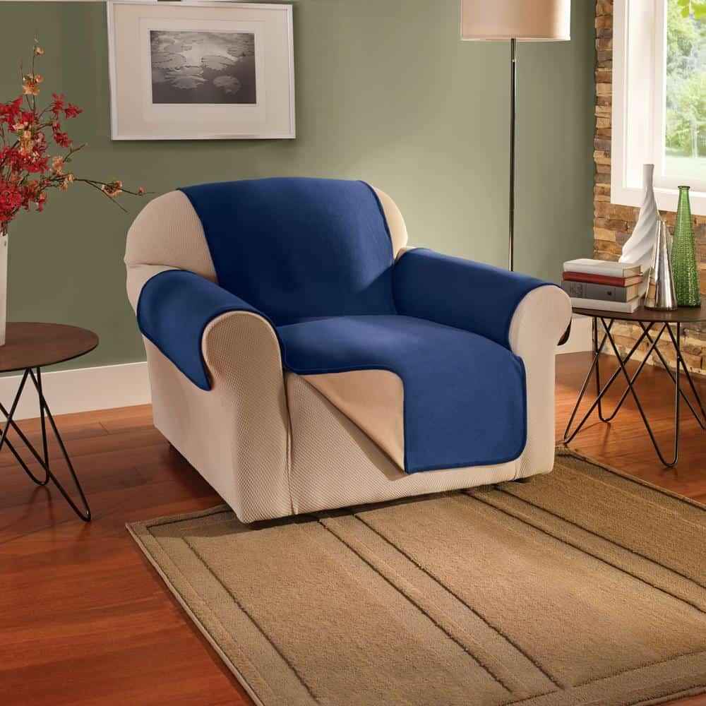 A dark beige, single sofa porected with a navy blue, fleece slip cover.