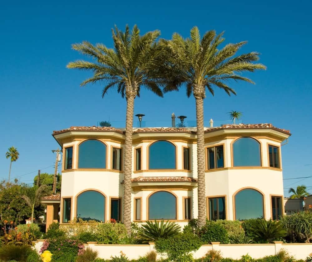 Luxurious ocean view stucco house with glazed windows.