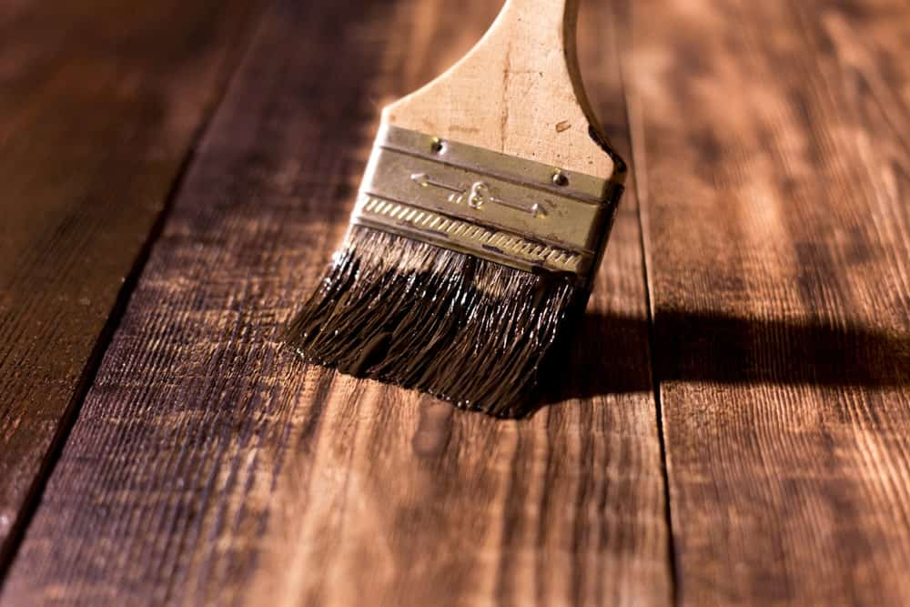 Paintbrush used to varnish a wooden surface.