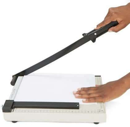 Paper trimmer used to cut paper into its desired size on white background.
