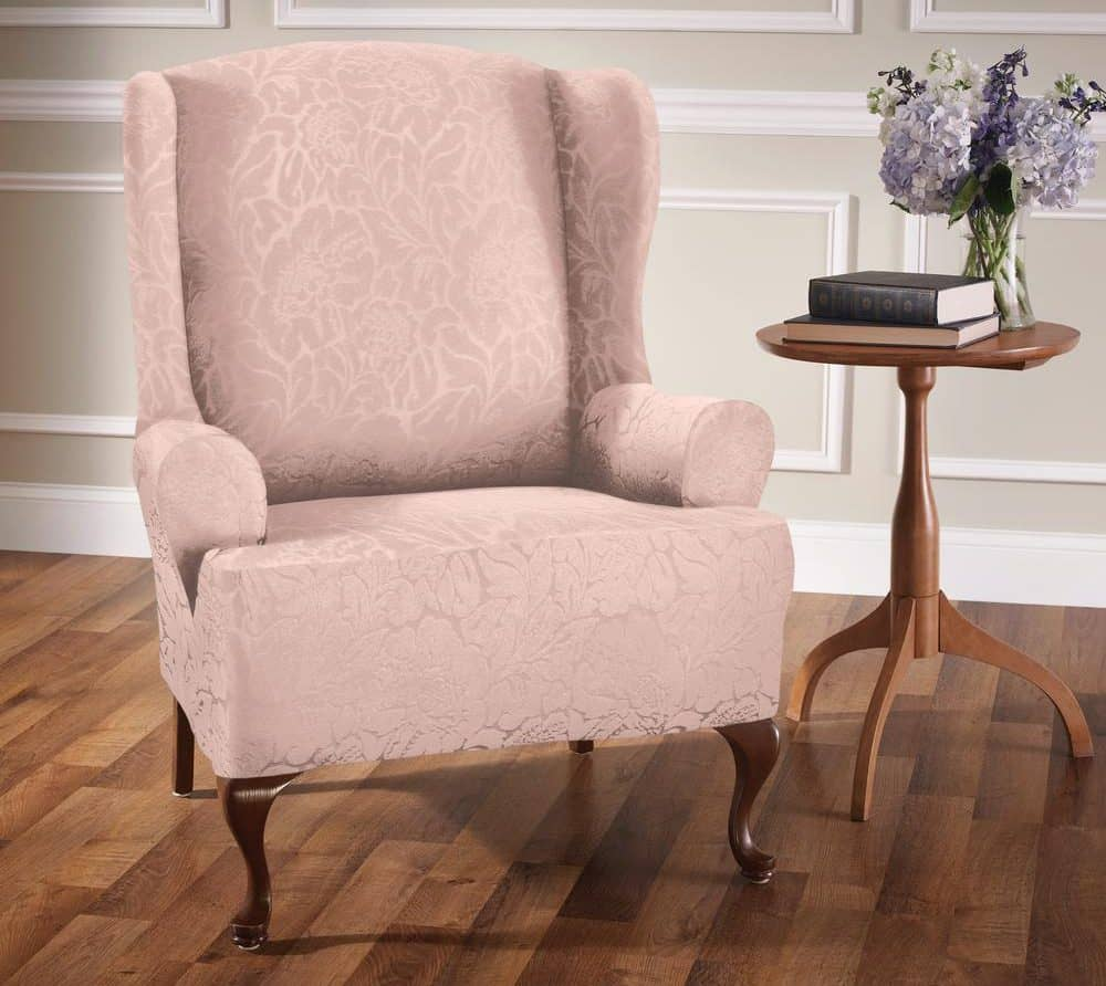 Pink armchair slipcover with a floral texture.
