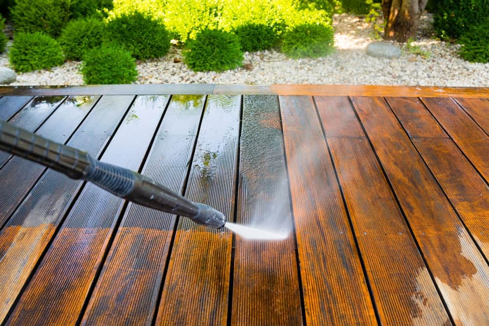 Pressure washer used to clean off the wooden surface of the terrace.