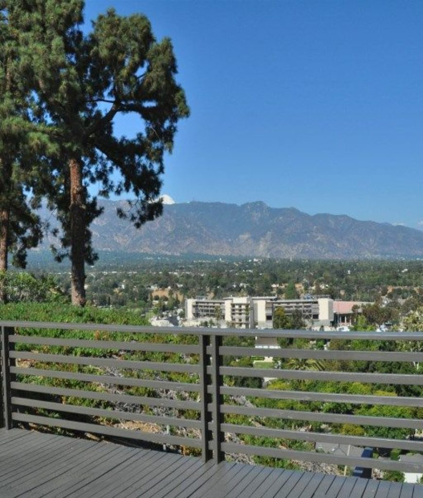 The deck overlooks the beautiful outdoor area.