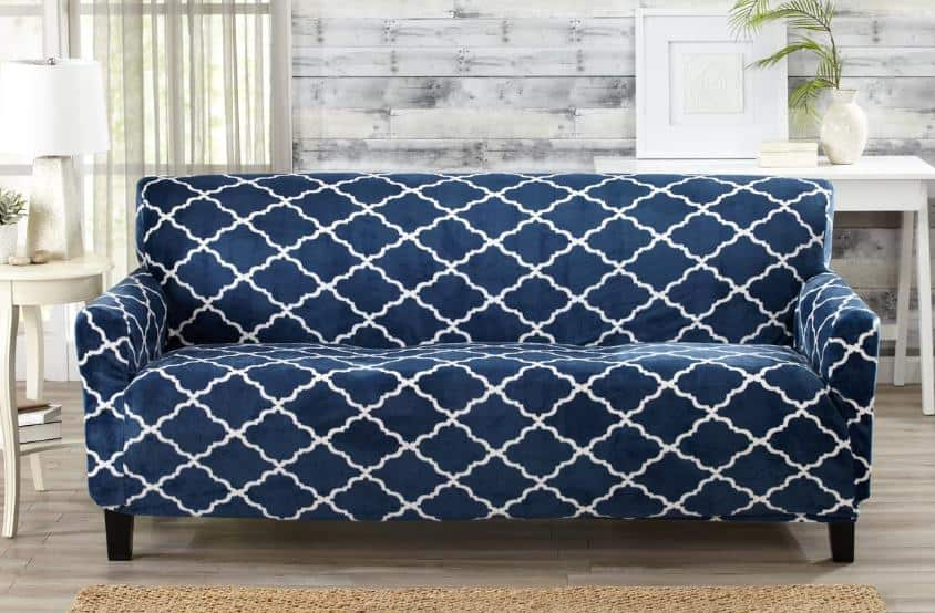 Royal blue, patterned slipcover with an elastic finish.