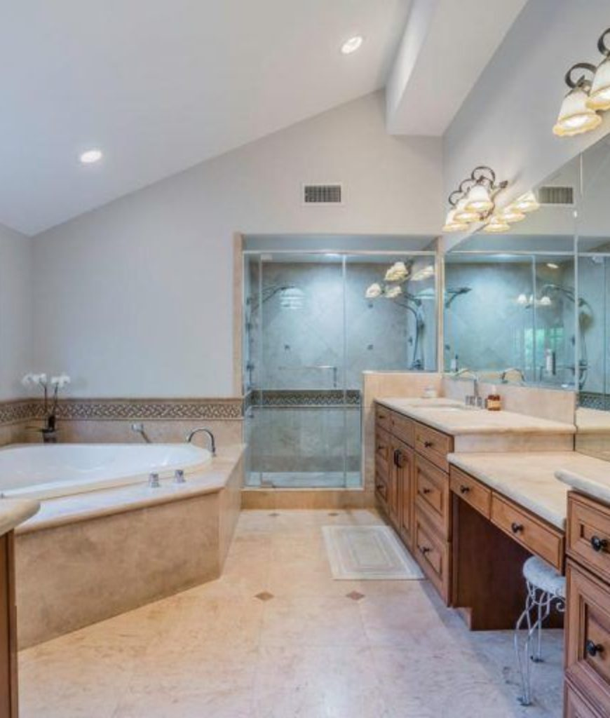 The bathroom features a complete bathtub, shower room and a powder area.
