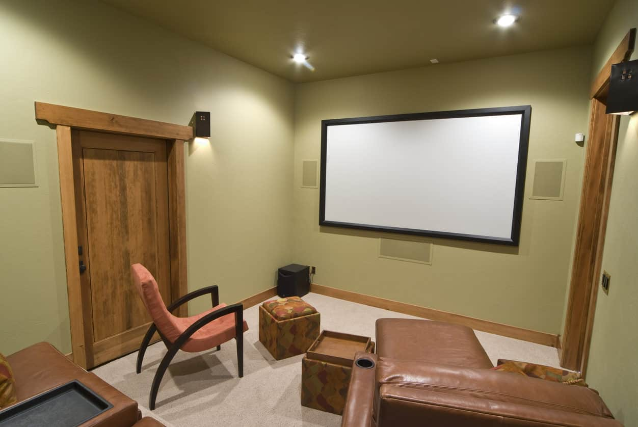 Perfect example of a bedroom converted to a home theater or a small space in the basement.