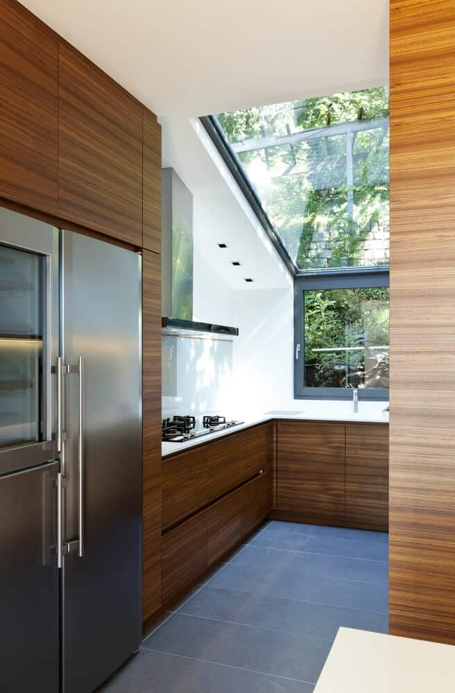 Tiny contemporary kitchen with glass angled ceiling.
