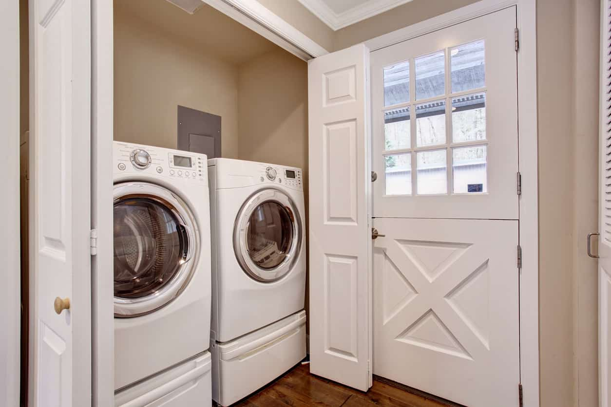 Closet laundry room with side-by-side washer and dryer in the mudroom.