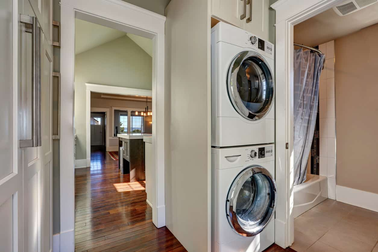 Stacked washer and dryer in bathroom off the kitchen.
