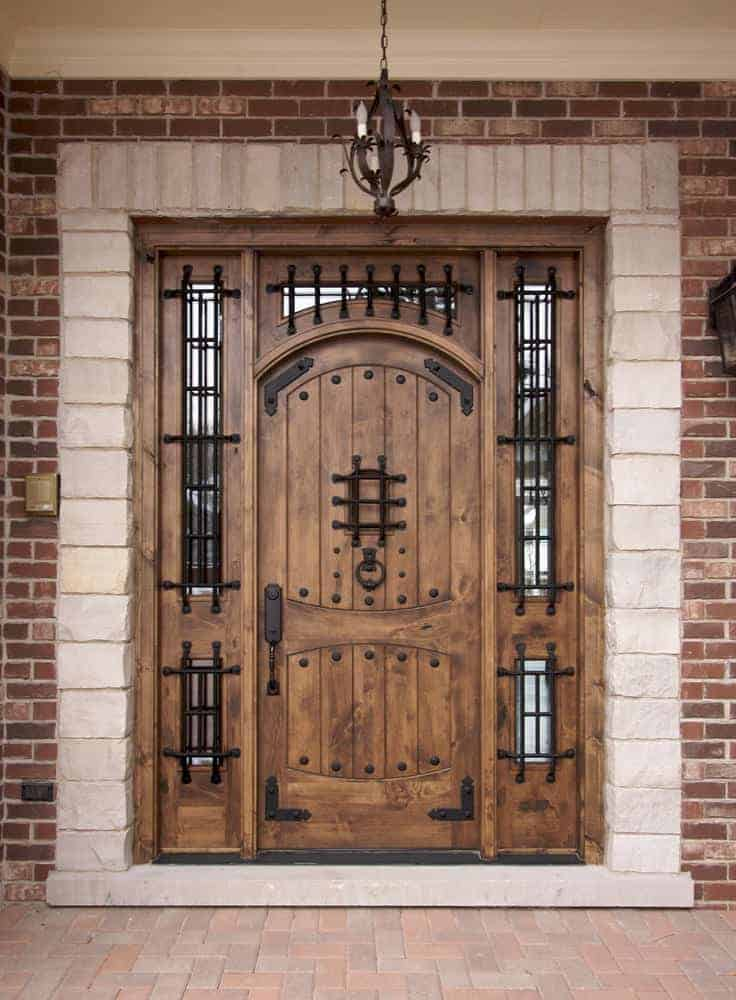 Solid wood and wrought iron front door with sidelites