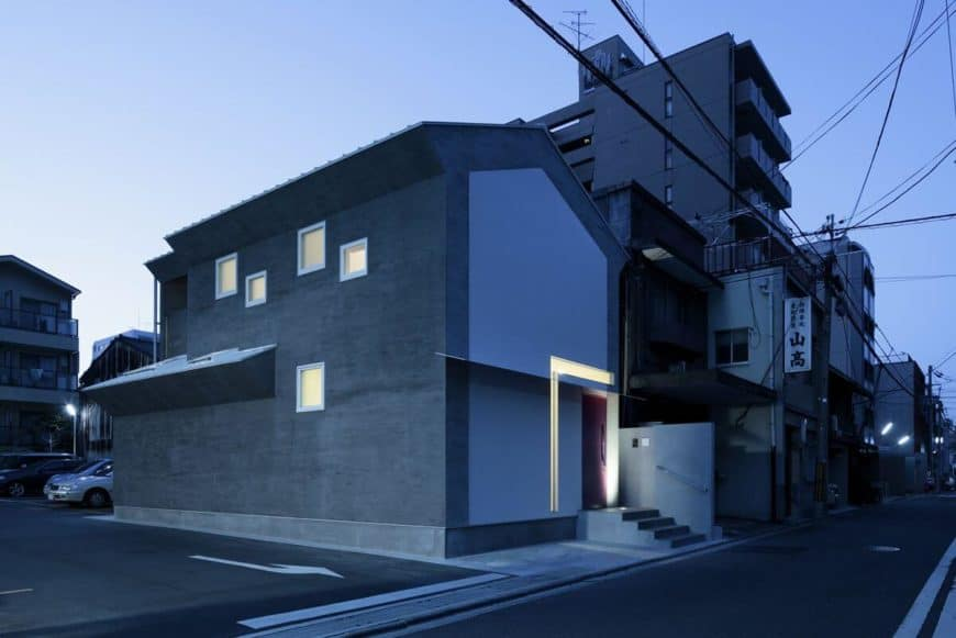 A modern house with a gray exterior. Its interiors are absolutely breathtaking as well.