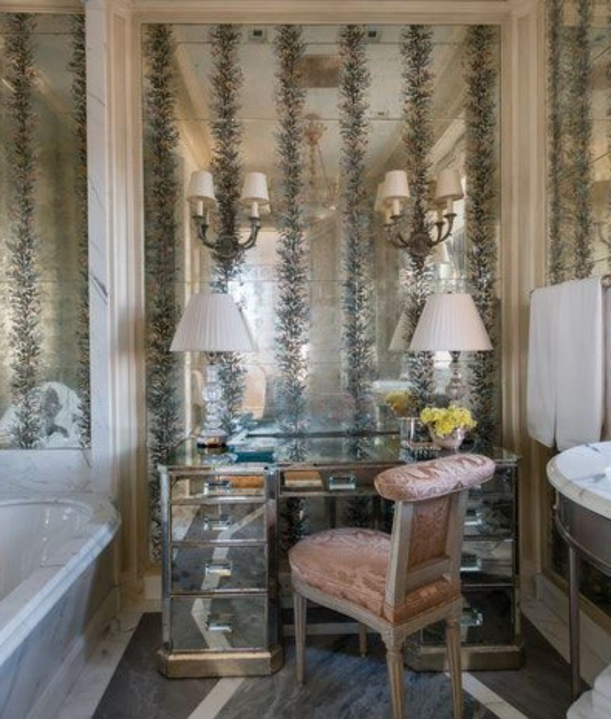 The bathroom boasts its stunning walls and marble soaking tub.