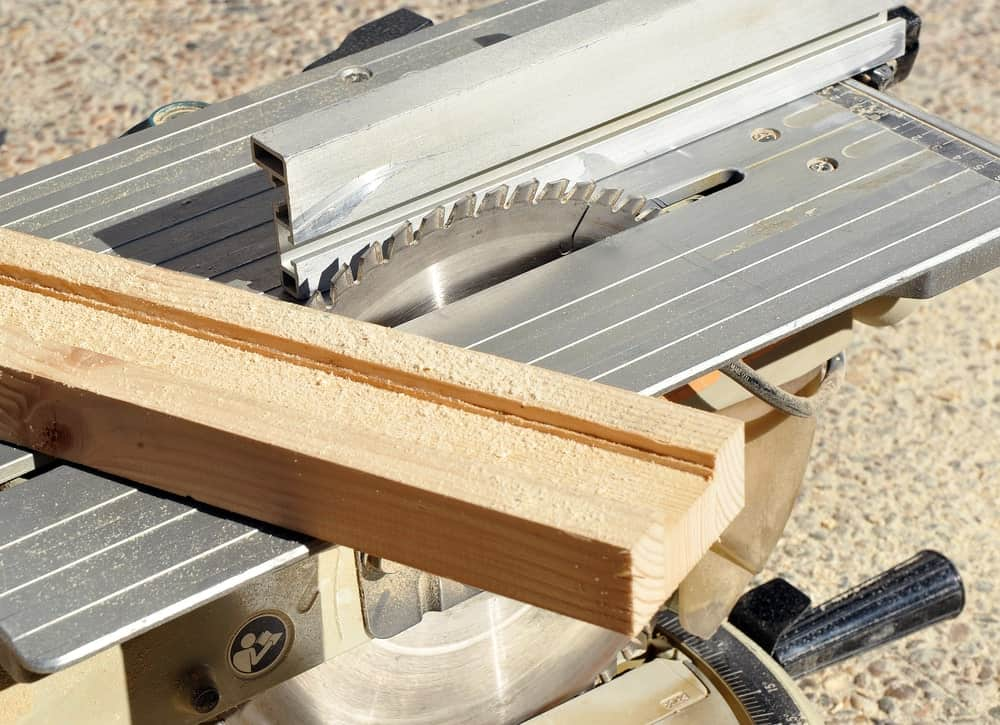 Table saw with a piece of wood.