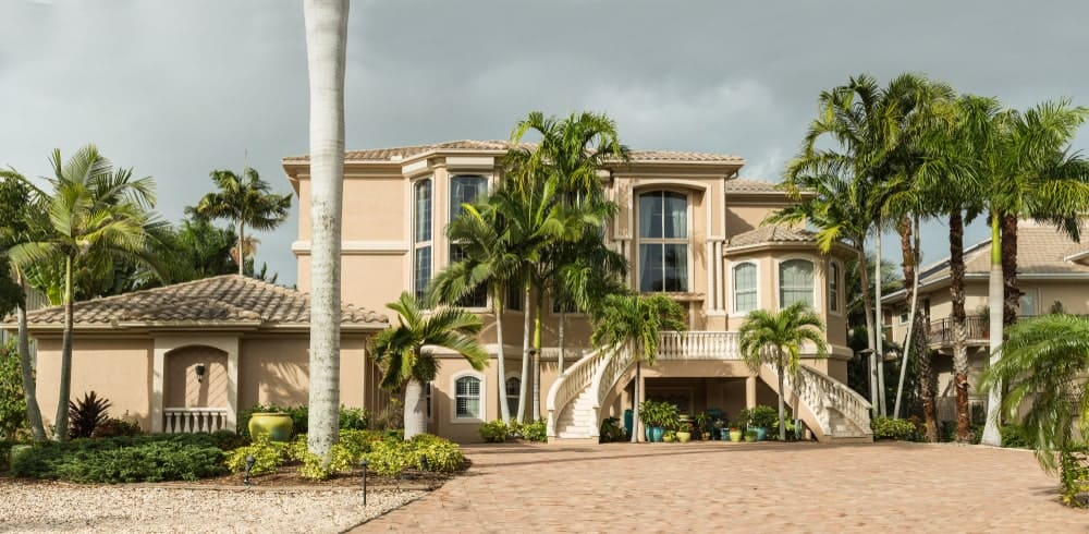 Typical Southwest Florida mansion with exterior bifurcated staircase.