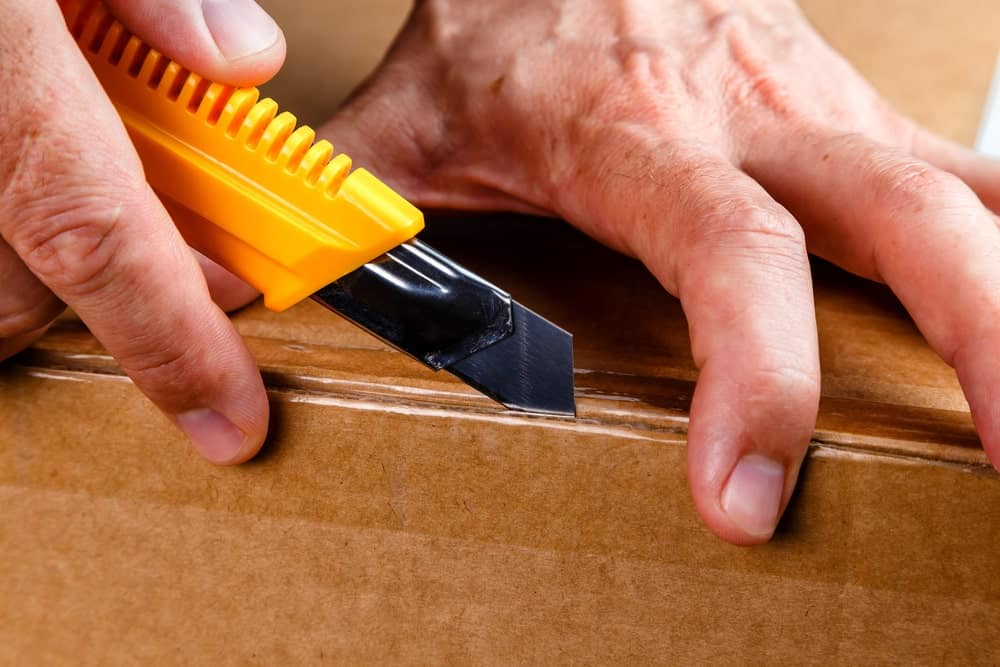 Utility knife used to open a box.