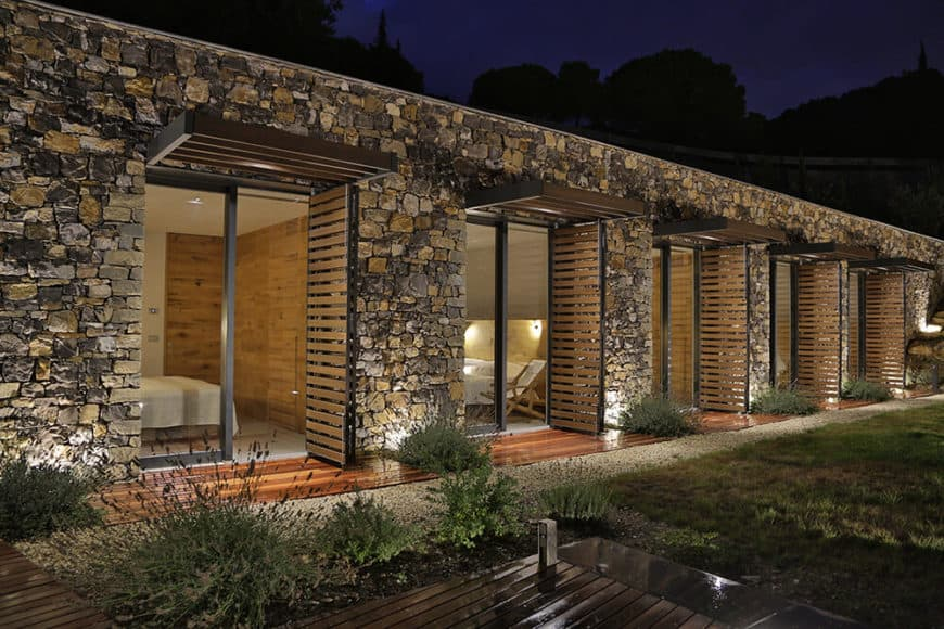This beautiful house features stone exterior and has a gorgeous garden area.
