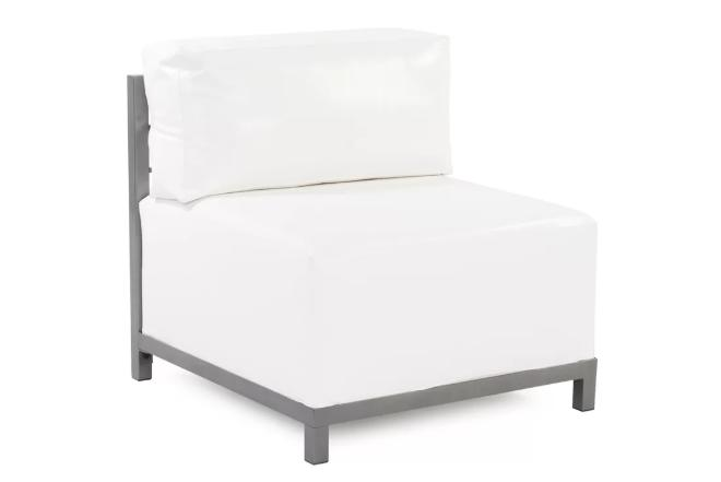 Small, box cushion sofa with a white slipcover.