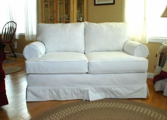 White, cotton slipcover for a standard-size love seat.