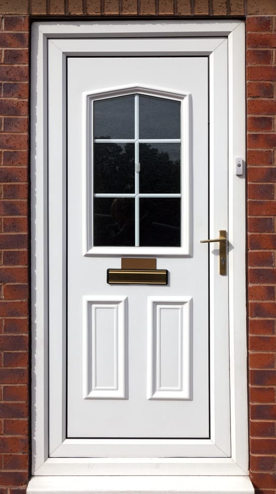 White fiberglass front door with a window