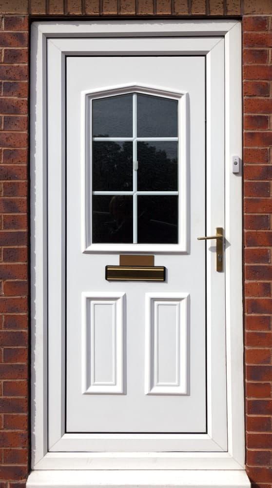 White fiberglass front door with a window