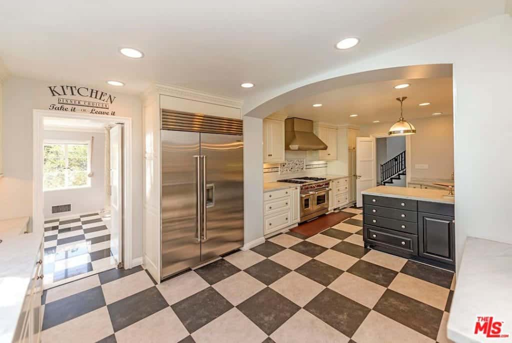 The kitchen features checker tiles floors and multiple recessed ceiling lights.