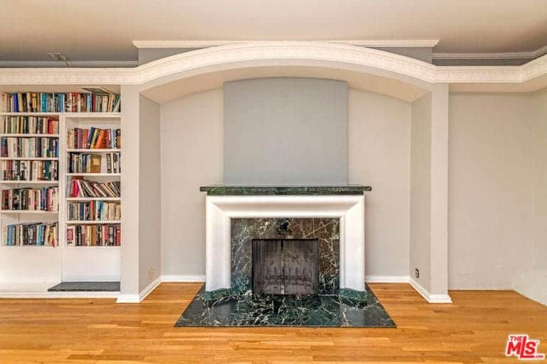 Another close up view at the home's fireplace in the library area.