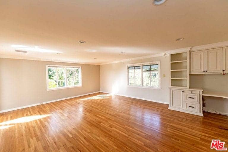 This room has a space for home office with its built in desk and shelves.