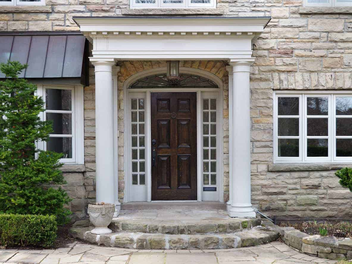 House wood front entry door with white trim