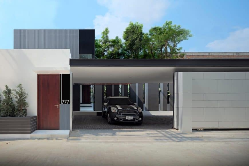 This home has a gray exterior and a covered garage.